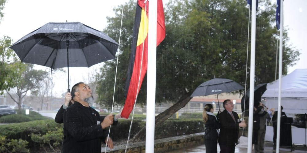 Shaun Nannup and Burns Beach MLA Mark Folkard take part in the flag raising ceremony. Picture: Chris Kershaw