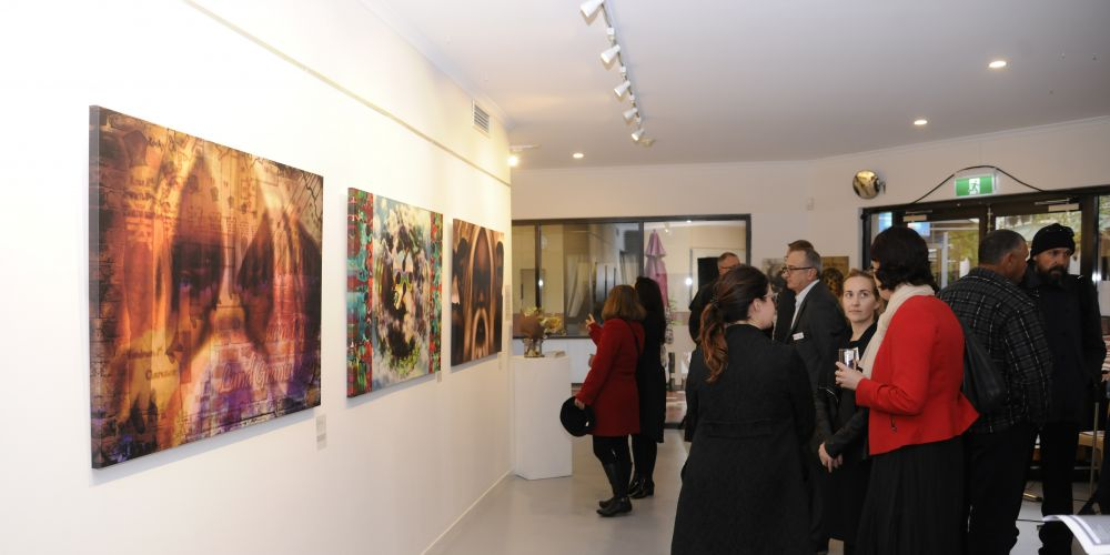 Guests at Charmaine Cole's exhibition Whadjuk's Kallip. Picture: Chris Kershaw