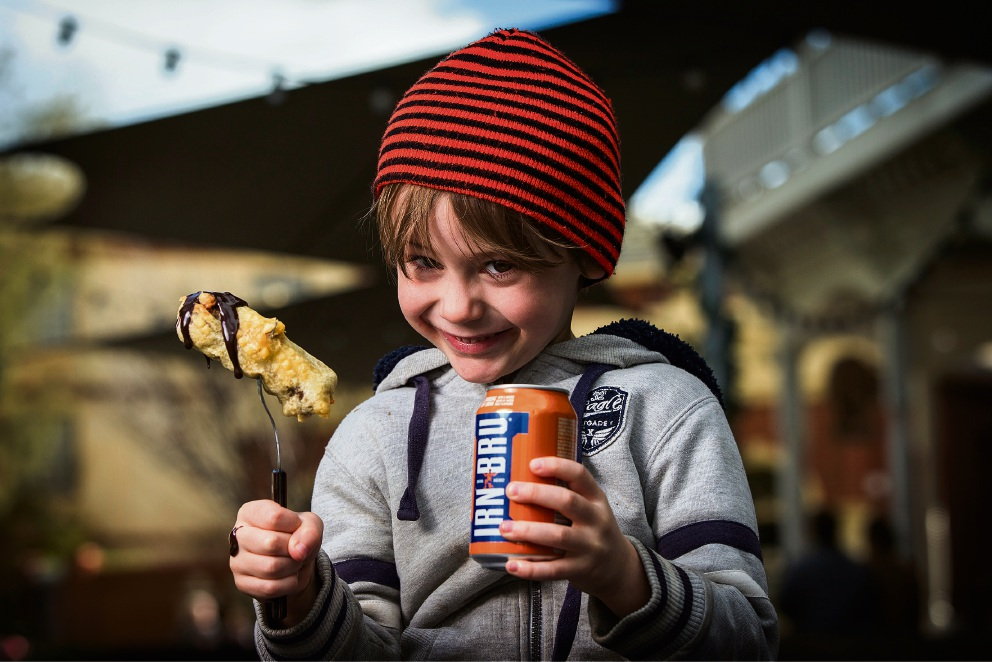 Griffin Jones with the Scottish-inspired deep fried Mars Bar and Irn Bru. Picture: Will Russell d470986