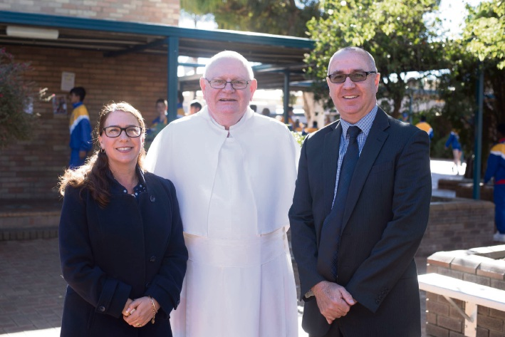 Simon Harvey (right) with current principal Annette Morey and Father Peter Stiglich O Praem.