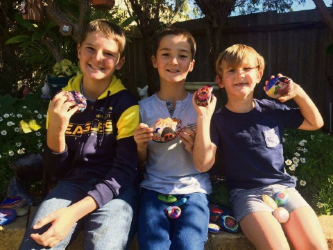 Mandurah boys Riley, Denvor and Coby Mitchell with their rocks.