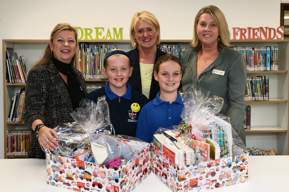 Students Bella Darcy and Kate Grigsby with head of primary Tracey Gray, head of primary library Jo-Anne Urquhart, and Ronald McDonald House events co-ordinator Natalie Farrow. Picture: Martin Kennealey www.communitypix.com.au   d469493