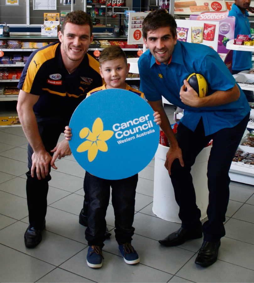 Dig Deep Day mascot Austin Melville with West Coast Eagles players Luke Shuey (left) and Andrew Gaff.