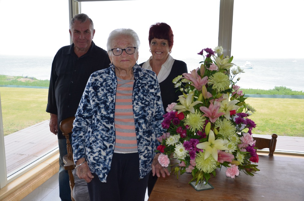 Olga Marshall celebrating her 100th birthday, with daughter and son-in-law Kaye and Tim Coleman.