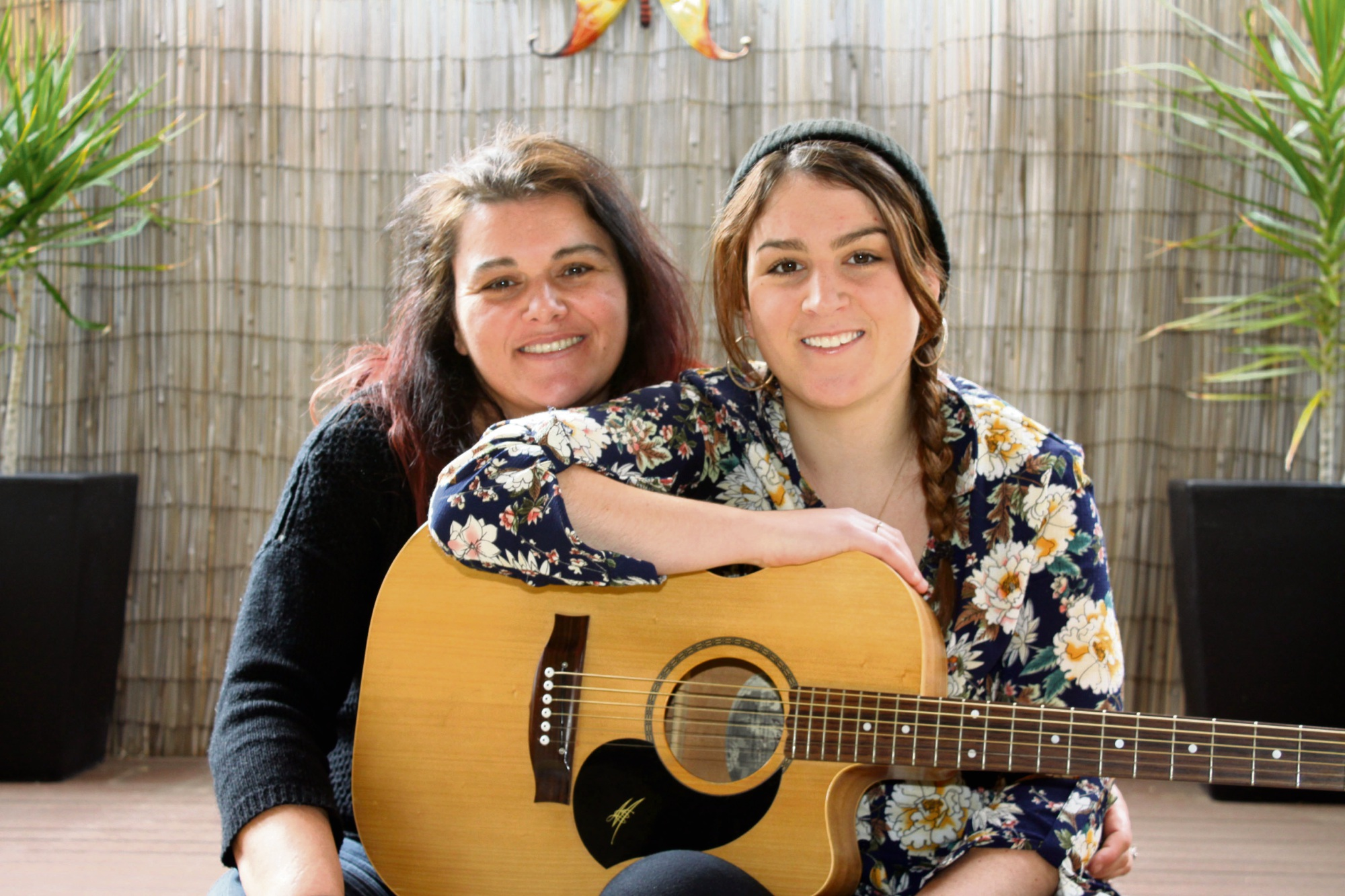 Depth beyond her years: Songwriter Jasmine Atkins, right, relaxing with her mother Lisa. Picture: Gabrielle Jeffery