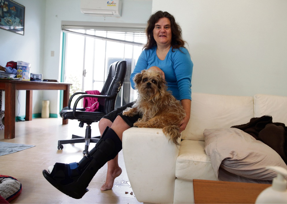 Suzanne Siranovic and her three-legged, nine-lived dog Ceasar. Picture: Martin Kennealey.