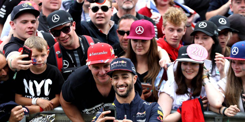 Daniel Ricciardo obliges fans with a selfie at Silverstone.