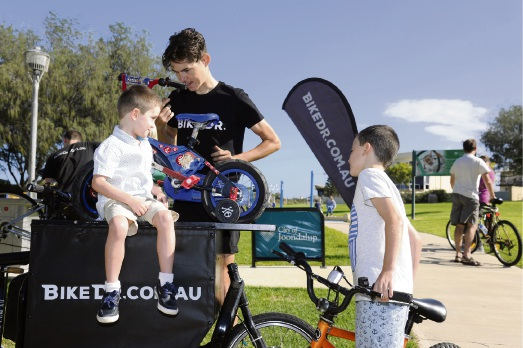 Noah and Juani Macey have their bikes looked over by a Bike Dr mechanic.