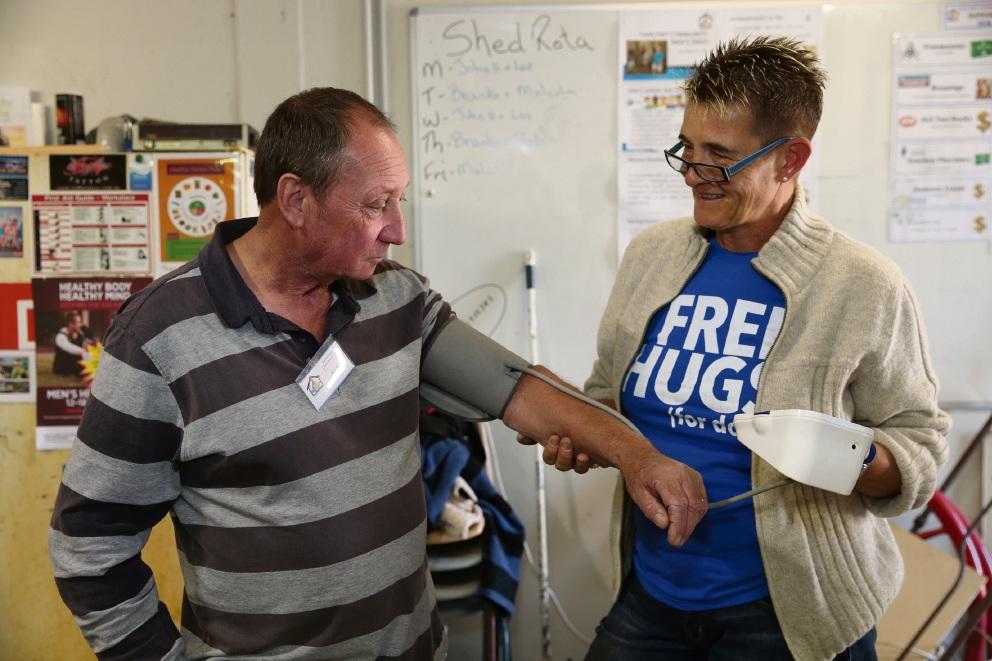 Ken Clutterbuck gets a health check from nurse Cora Babenschneider.