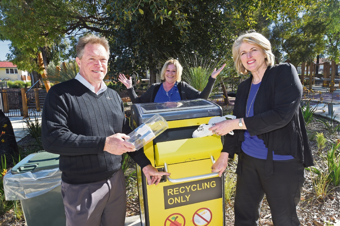 Environmental health co-ordinator Chris Tanner, wasteeducation officer Trish Kursar and Mayor Carol Adams with the new bins.