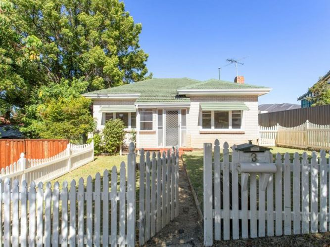This house on Rosebery Street, which has a large tree, was sold in 2017 by Ray White Uxcel for $440,000.