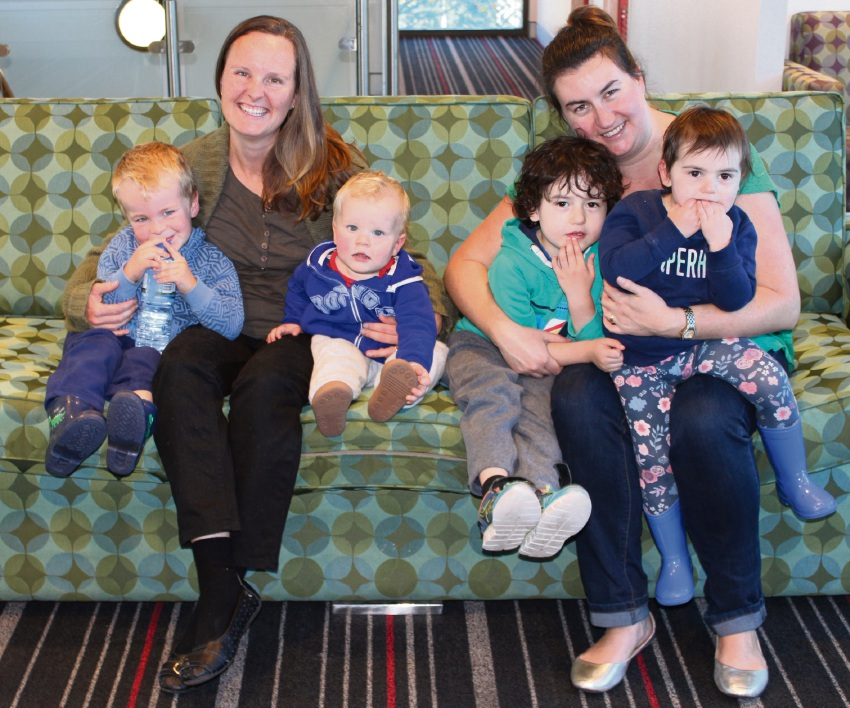 Bonnie Madsen and Carolyn Mitchell with their children.