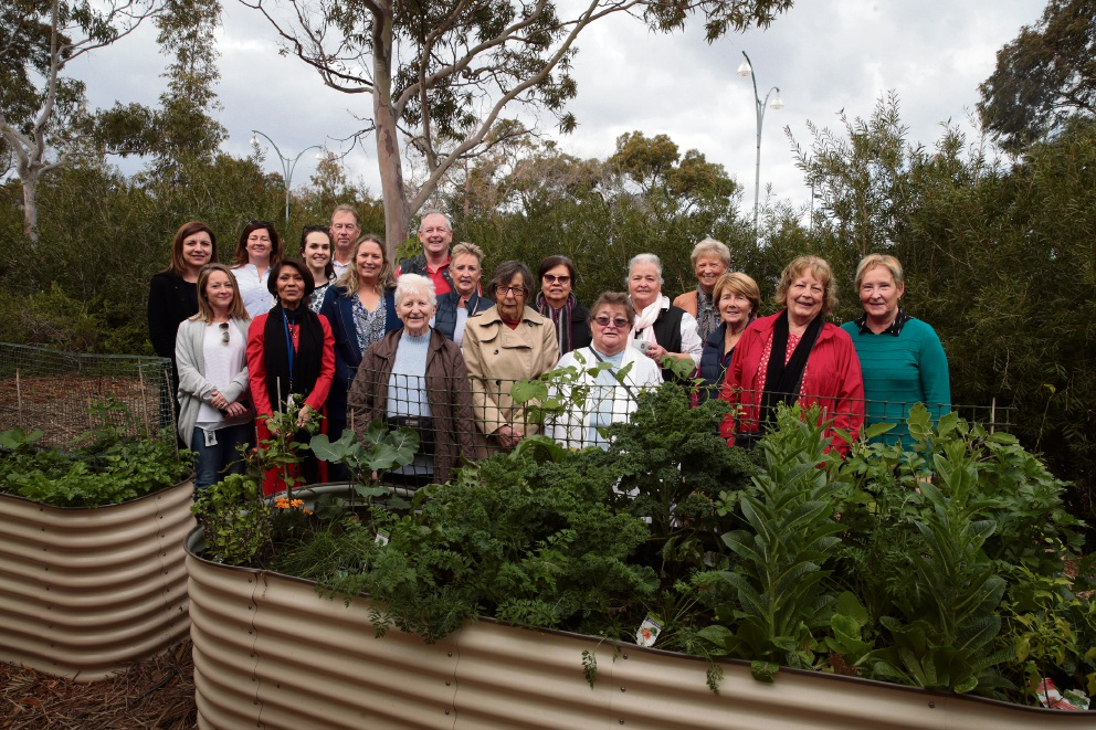 Kyle Court residents and supporters in the new community garden. Picture: Martin Kennealey