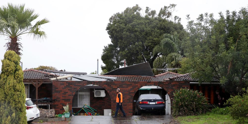 This Hamersley home lost its roof. Photo: Martin Keannealey