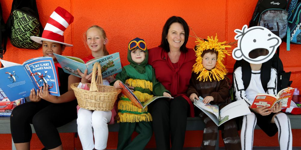 Perth Airport chief corporate services officer Debra Blaskett with Angel Lauama, Lara-Jade Rivette, ,Cori Green, Beau Thompson and Ben Bowry  enjoying some of the new books. Picture: Martin Kennealey www.communitypix.com.au   d473135
