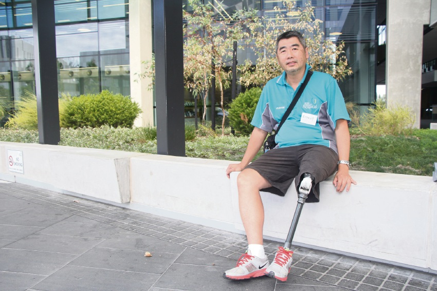Ernest Chu, whose left leg was amputated after an infection, volunteers at Princess Margaret Hospital to help others through the process of emotional and physical recovery.