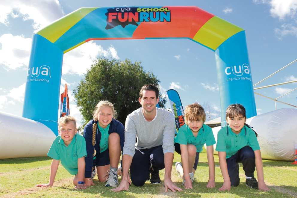 Yidarra Catholic Primary students Kaj Winfield, Charlie Winfield, Ari Lindner and Olivia Vahala caught up with Olympian Eamon Sullivan at the school's fun run.
