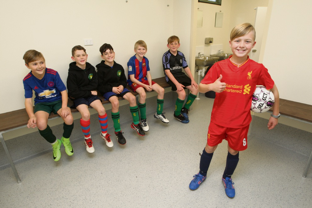 Harrison Peet and under 11's soccer players  give the shiny new changerooms the thumbs up