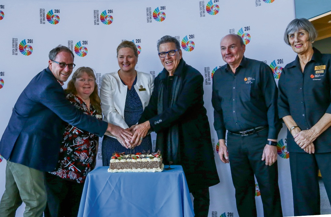 Cuttng the cake: MPAC general manager Guy Boyce, Linda Brough, Mayor Marina Vergone, Sacha Mahboub, Brian Owen and Penny Husen cut the cake celebrating 20 years of the Mandurah Performing Arts Centre