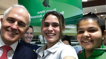 Shanaya Fullgrabe (left) takes a selfie with PM Malcolm Turnbull and Bertha Moore (in white).