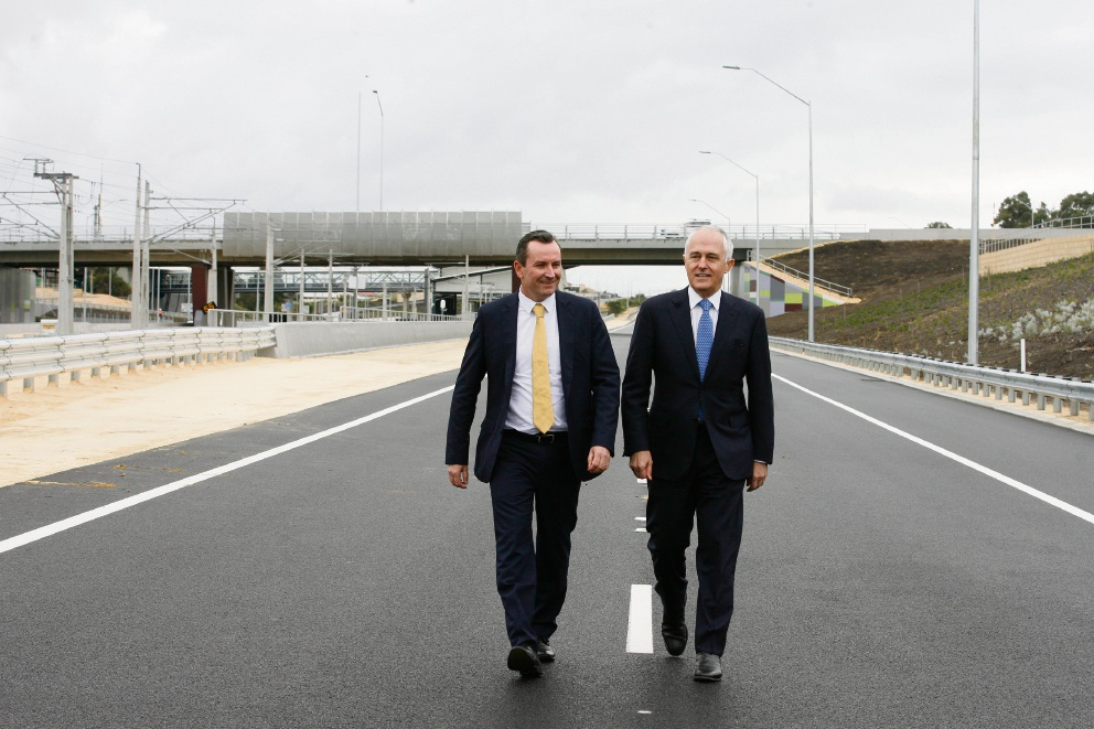 WA Premier Mark McGowan and Prime Minister Malcolm Turnbull taking a stroll on the new freeway extension. Picture: Marie Nirme d472369