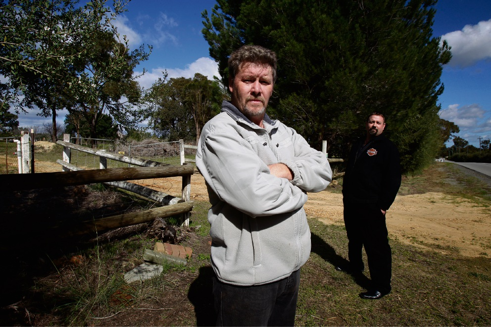 Church not welcome here: Concerned residents Rodney and Nathan Smith at the site of proposed church