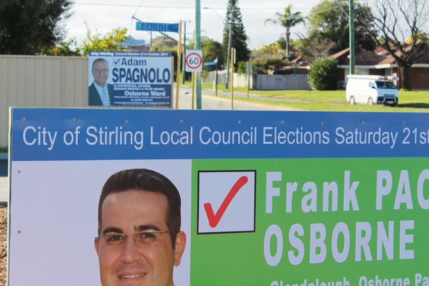 Adam Spagnolo and Frank Paolino's election posters are not meant to be up before nomination day, which for these elections is September 7