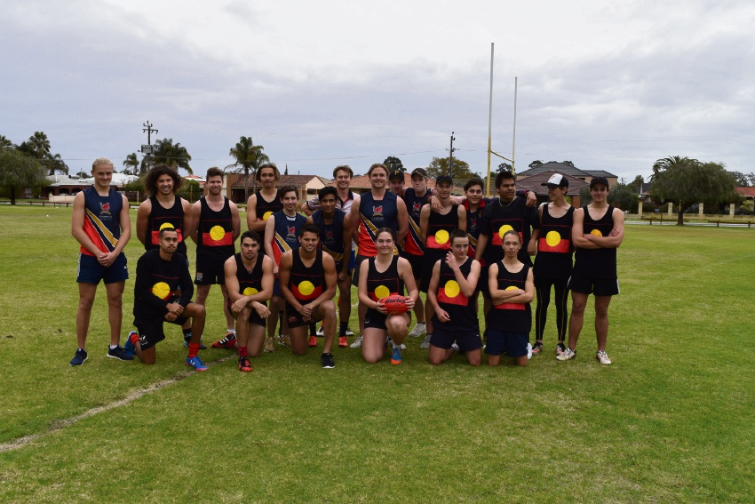 Hampton SHS Indigenous team playing against the Non-Indigenous team in the All Stars AFL Game.