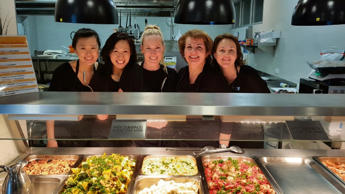 Team from LJ Hooker Dalkeith-Claremont helps chefs at Ronald McDonald House