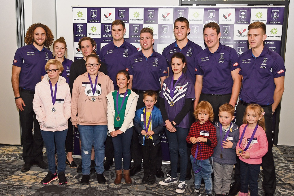 Dockers players with some of the children at the AJ Diamond Club Bravery Awards. Little Billy Baxter, whose hand survived an accident with a juicer, is the red checked shirt. Picture: Jon Hewson www.communitypix.com.au d472421