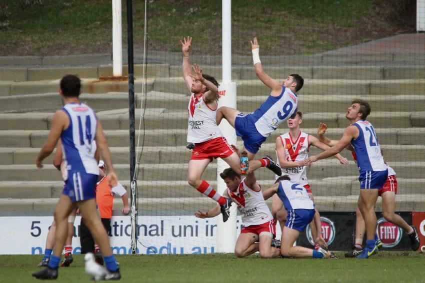 East Fremantle's Jack Perham attempts a grab over South Fremantle's Brock Higgins. Picture: Phil Elliott
