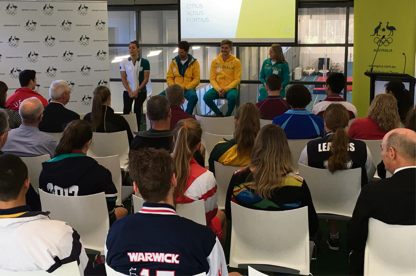 Olympians Blair Evans (swimming), Danielle Kettlewell (synchronised swimming), Jesse Phillips (kayaking) and Stephen Bird (kayaking) speaking to students.