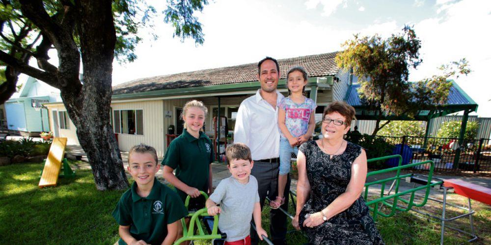 Casa Mia Montessori School board chairman Claudio Pellegrini, principal Janet Laing and students.