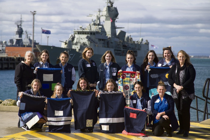 Comet Bay College year 11 and 12 Creative Class students and teachers proudly show off their hero bags at HMAS Stirling, before presenting them to sailors from HMAS Stuart and HMAS Dechaineux. Pictures: Able Seaman Richard Cordell.