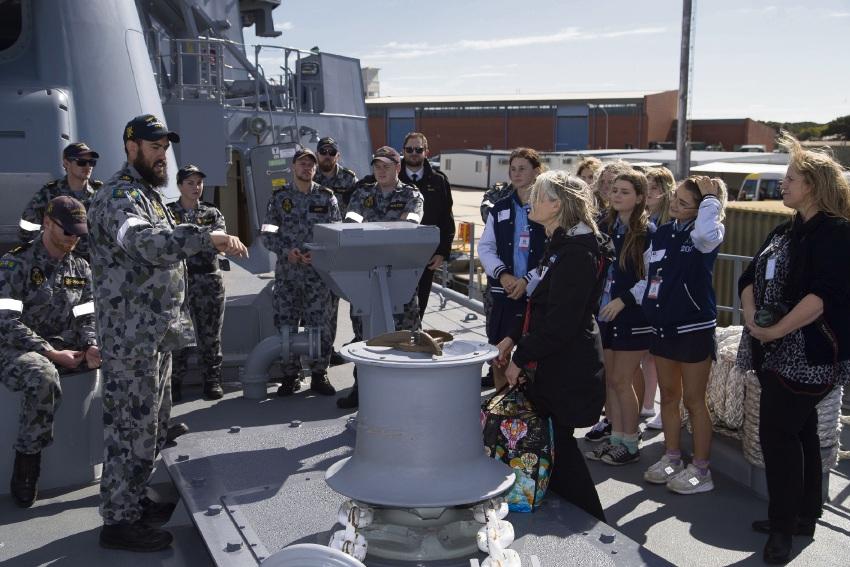 Leading Seaman Matthew Reiri explains his role aboard HMAS Stuart to Comet Bay College students.