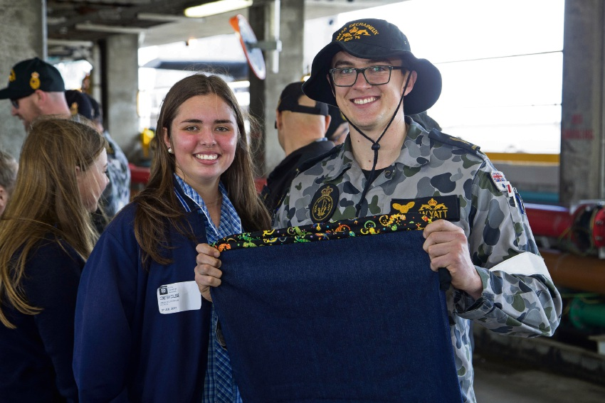 Able Seaman Alastair Wyatt proudly displays his new hero bag with Shaye Maher.