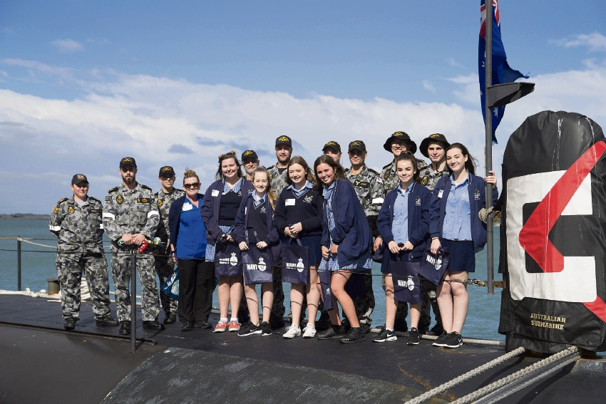Comet Bay College students gather with submariners on the casing of HMAS Dechaineux.