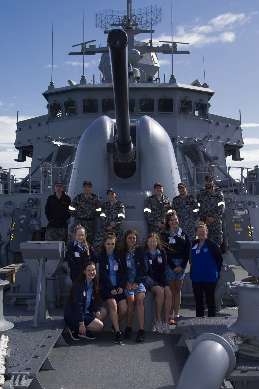 Comet Bay College students gather with sailors on the forecastle of HMAS Stuart.