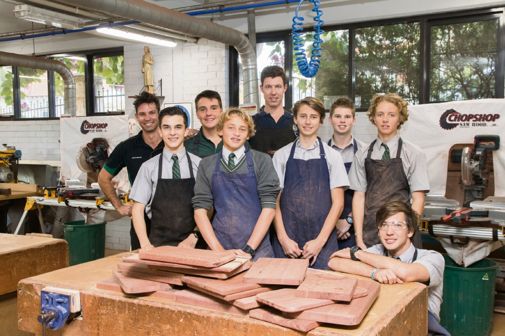 CBC students with their handmade chopping boards, which were donated to St Patrick's Community Support Centre. Picture: Keane Bourke