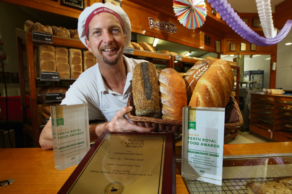 From the dole to the dough: Nathan Merrett with his bread and awards. Picture: Bruce Hunt