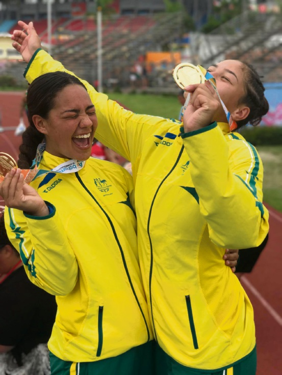 Langley Sesega and Kennedy Cherrington savour their golden moment at the Youth Games.
