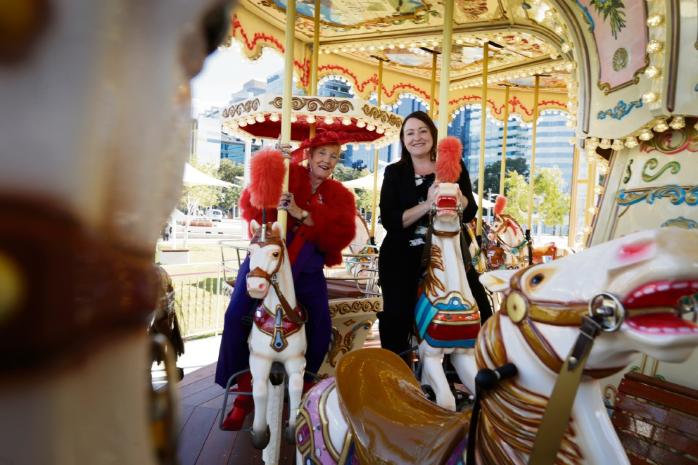 Fun and frivolity at the Quay: Red Hats member Anna Eastment and Member for Joondalup Emily Hamilton on the Elizabeth Quay Carousel. Picture: Andrew Ritchie www.communitypix.com.au   d472302