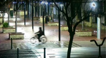 A screen shot of a person on a bicycle police wish to identify to assist with their investigation.