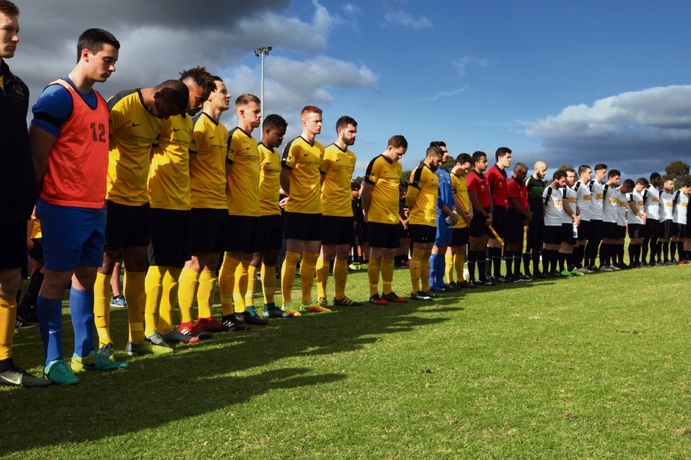 Players observe a minute's silence before the match. Picture: Bruce Hunt d472485