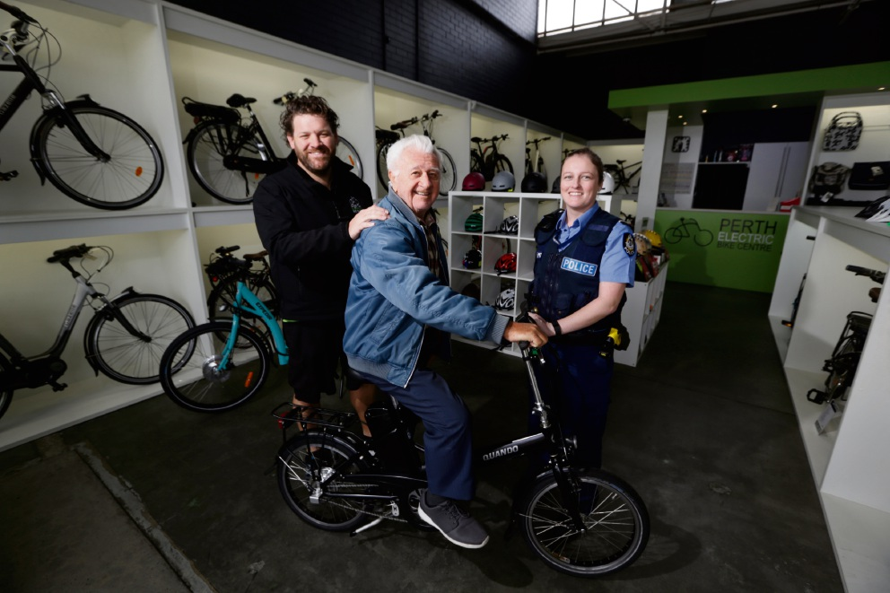 Perth Electric Bike Centre's Matt Cruickshank with Mihary Ceke and First Class Constable Kylie Allison. Picture: Andrew Ritchie d472412