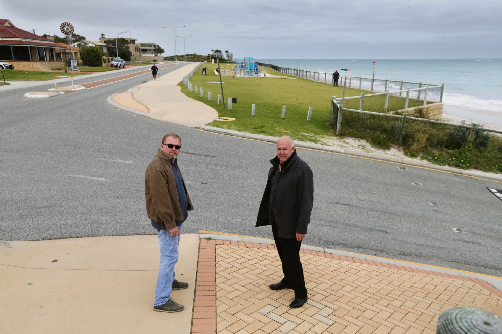 Dangerous curves: Quinns Rocks residents Steve Woodcock and Robin Schneider say the Fred Stubbs playground is in the wrong - and very dangerous - location. Picture: Martin Kennealey
