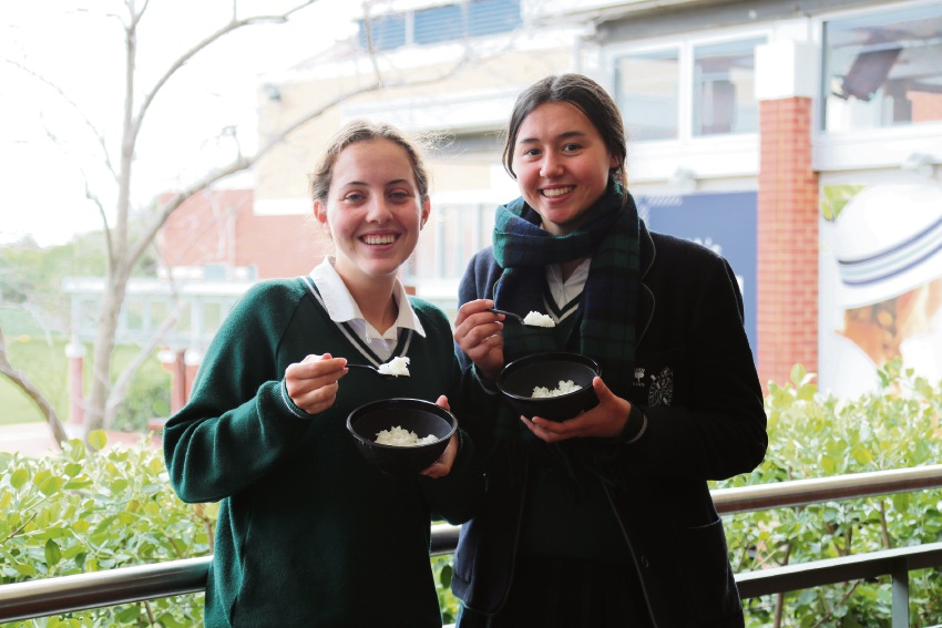 Giorgi Devereux (left) and Olivia Tan were two of 35 PLC students who took part in the Oaktree Foundation's Live Below the Line challenge, shining a light on the 1.3 billion people living in extreme poverty.