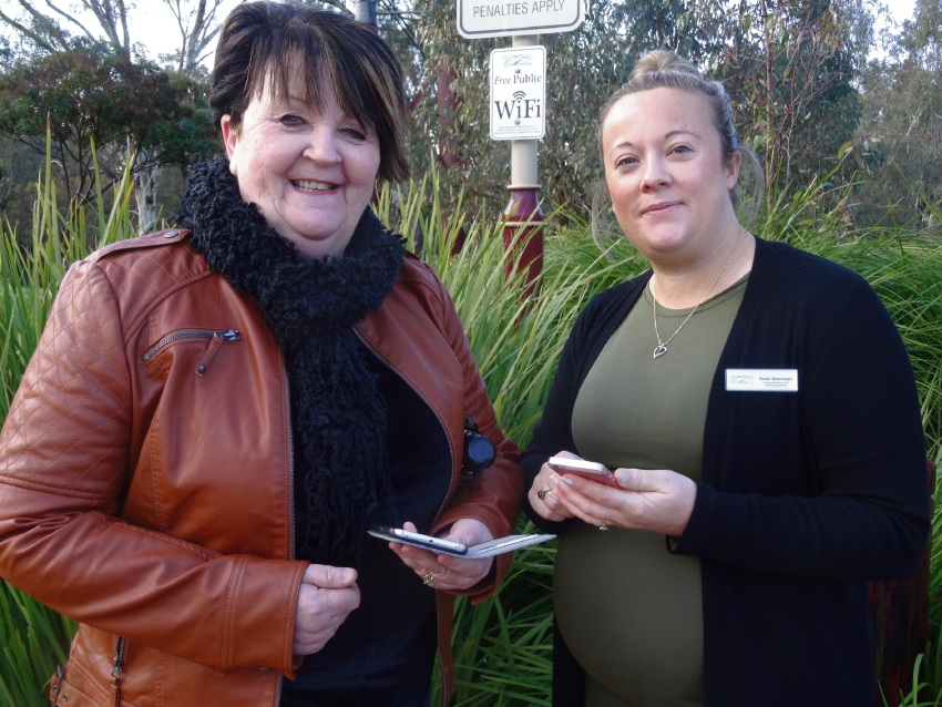 Shire president Maree Reid and council officer Katie Dennison test the free public WiFi