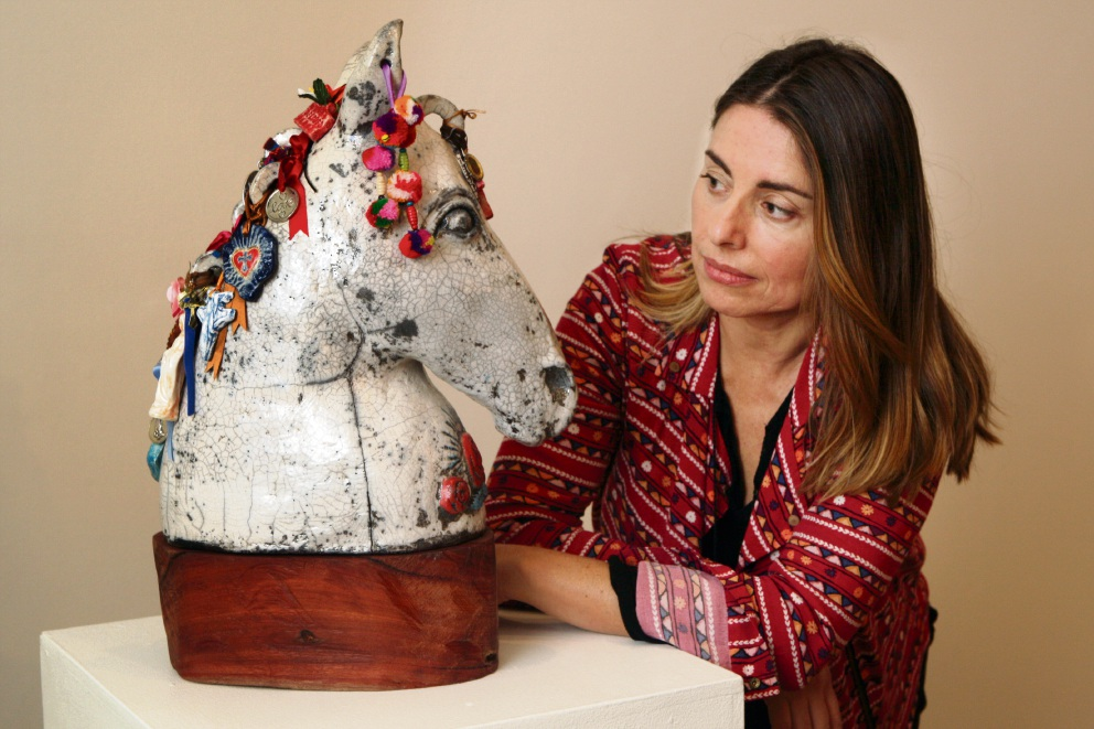Sculptor Marcia Espinosa with her ceramic work The Protector, inspired by a Chilean tradition. Picture: Bruce Hunt www.communitypix.com.au d471723