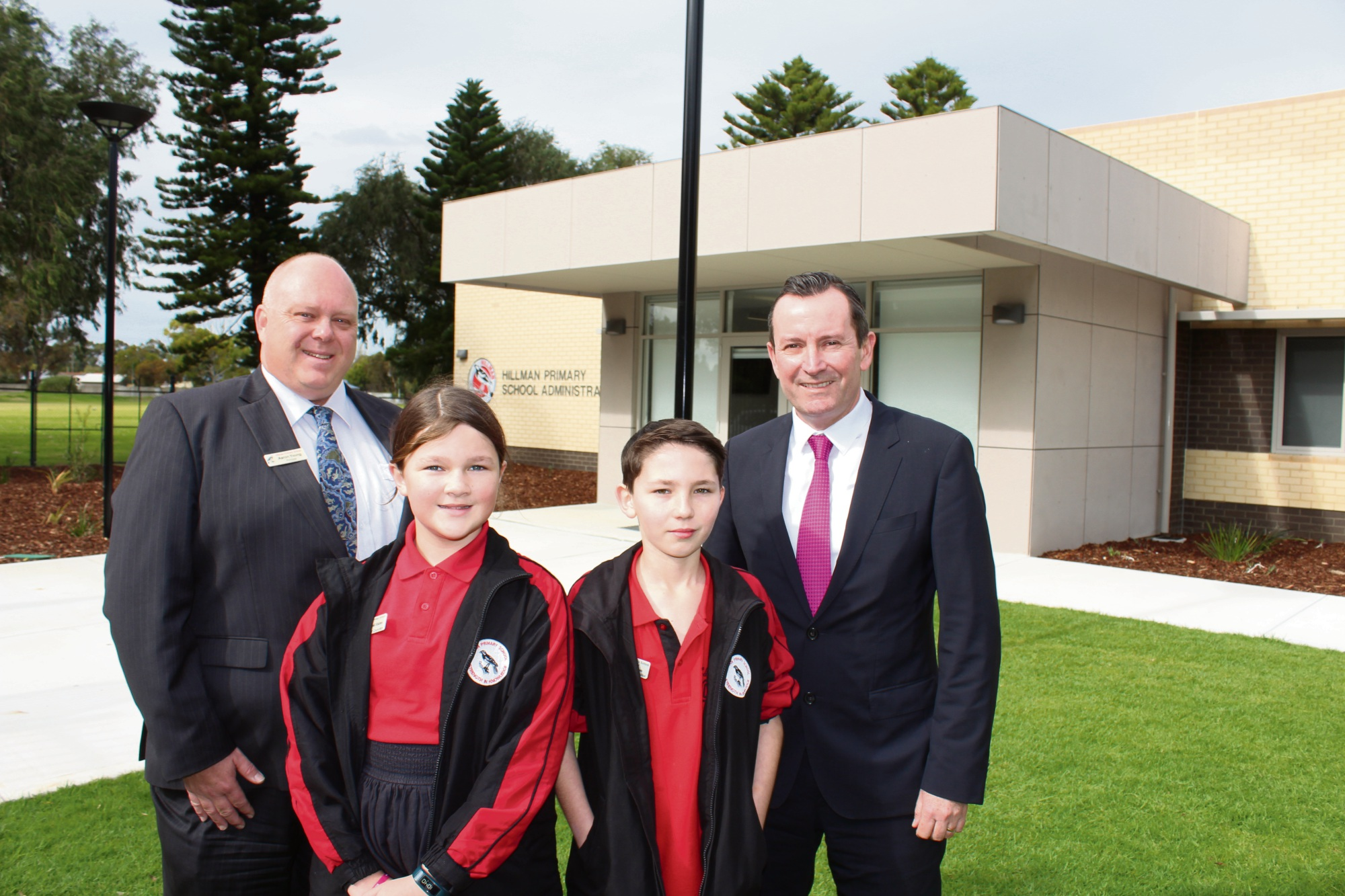 Hillman Primary School principal Aaron Young, year six students Abigail Ekins and Daniel Richardson, who are on the Rockingham Junior Council, and Premier Mark McGowan out the front of the new administration building this morning.